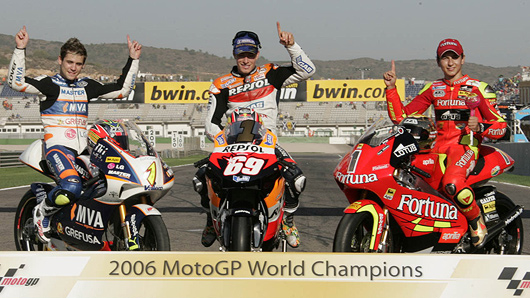 The 3 new 2006 MotoGP World Champions: (left to right) 125cc Alvaro Bautista on Aprilia, 990cc Nicky Hayden on Honda, 250cc Jorge Lorenzo on Aprilia.